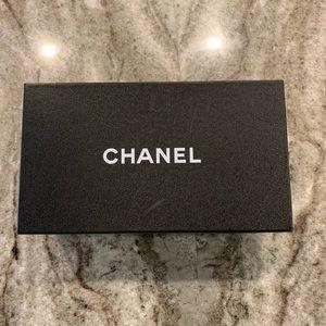 Black Chanel pumps